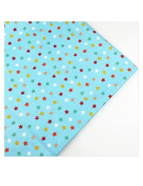 Ткань цветные звезды на голубом